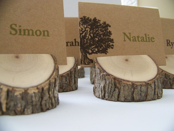 with the rustic wedding theme check out these wood place card holders by